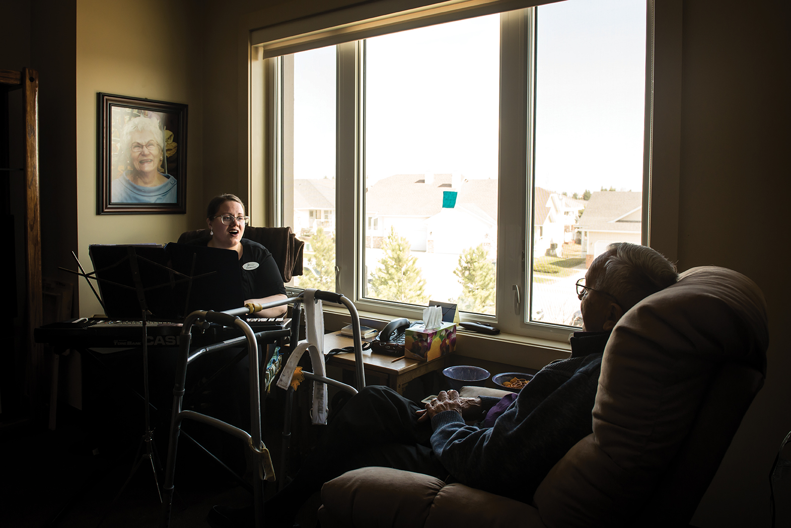 Walter Mitsonhe visits with therapist Rebecca Woodruff.