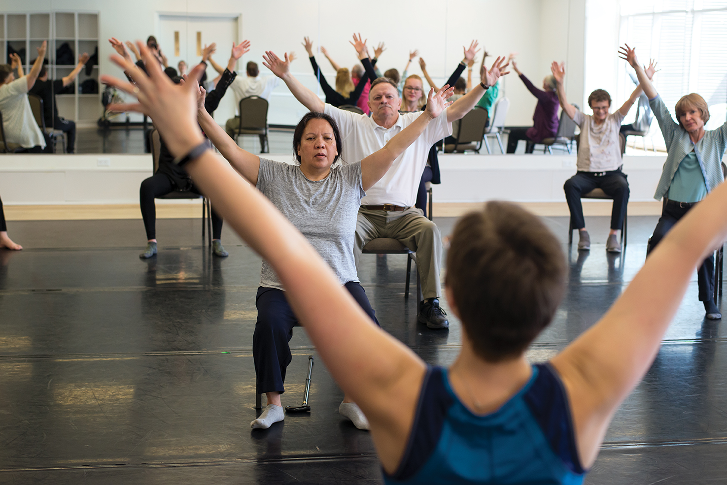 Participants get moving during a Dancing Parkinson's YYC session at Decidedly Jazz Danceworks.