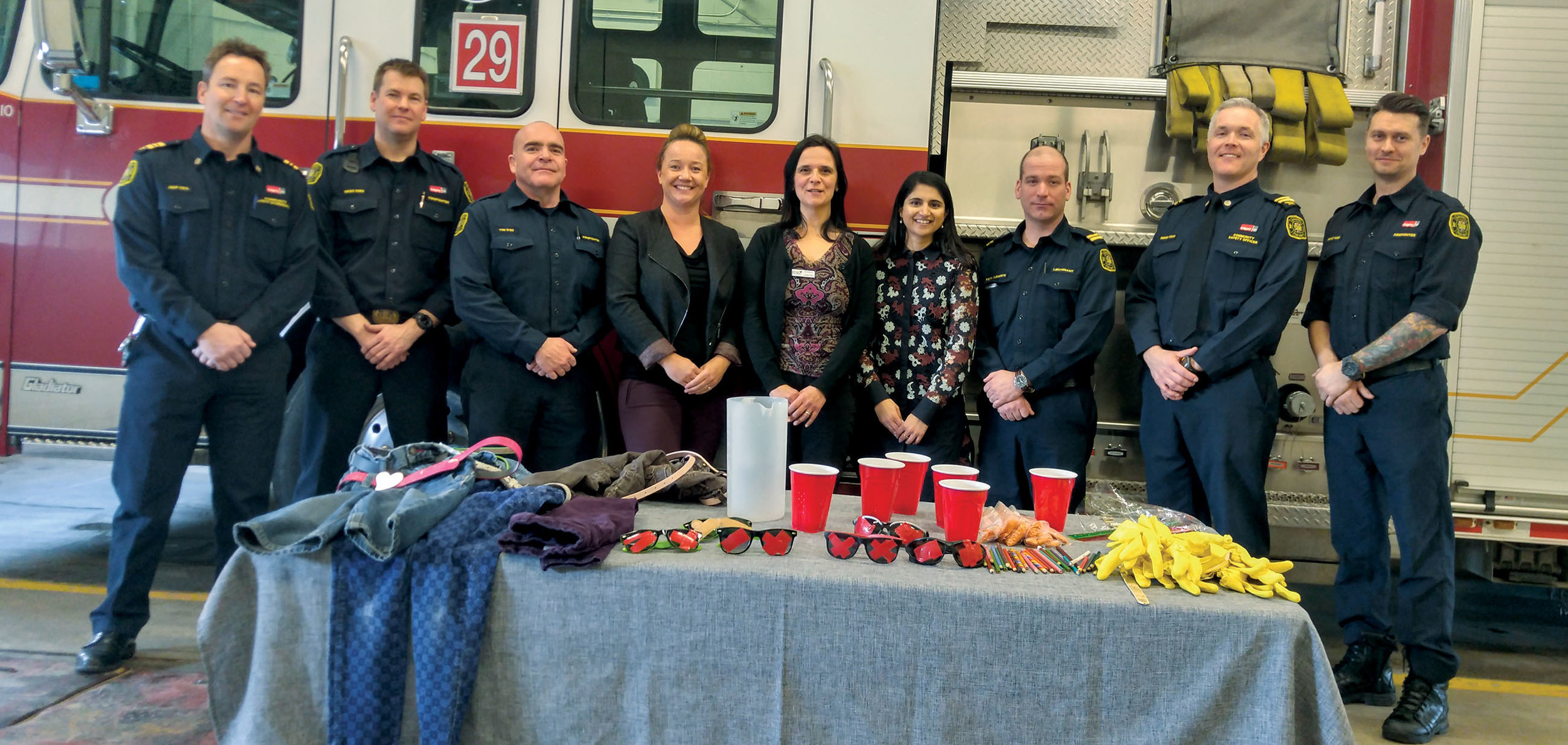Firefighters, City staff and representatives from the Brenda Strafford Foundation stand together in Station 29 after a dementia awareness training exercise, part of the Dementia Friendly Communities partnership between the organizations.