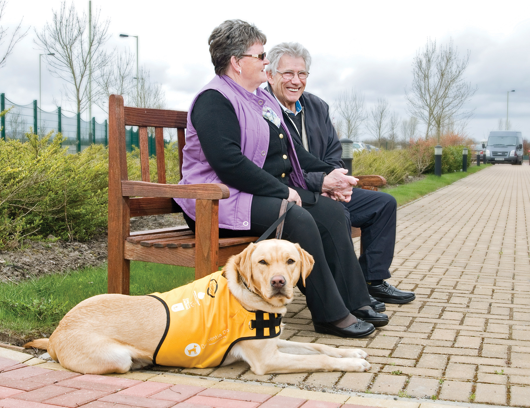 Ken and Glenys Will with their dementia assistance dog, Kaspa.