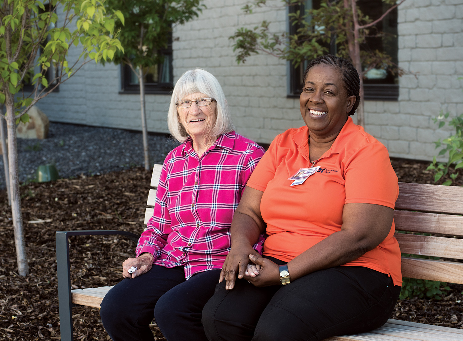 Cynthia Delgado (right) and Marj enjoy spending time together at St. Teresa Place. Photo by Jared Sych.