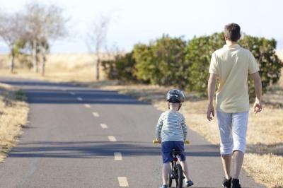 kid-on-bike-with-dad-walking.jpg