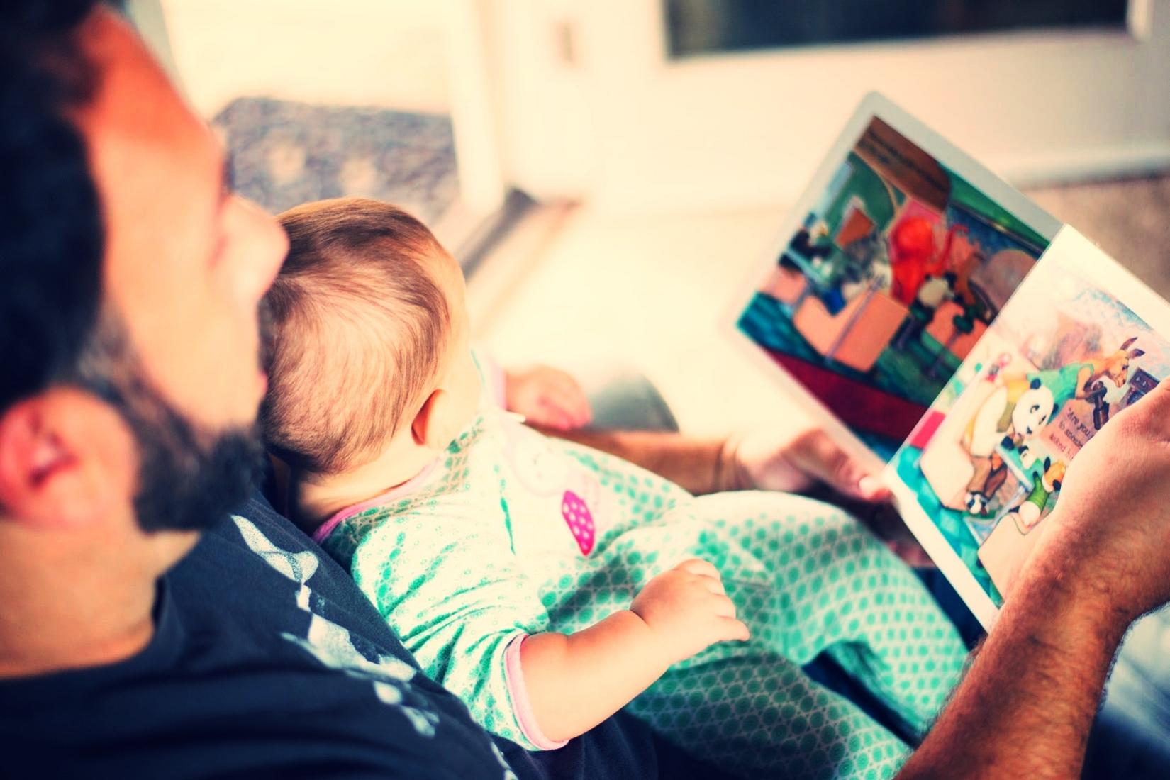 Dad Reading to Kid.jpeg
