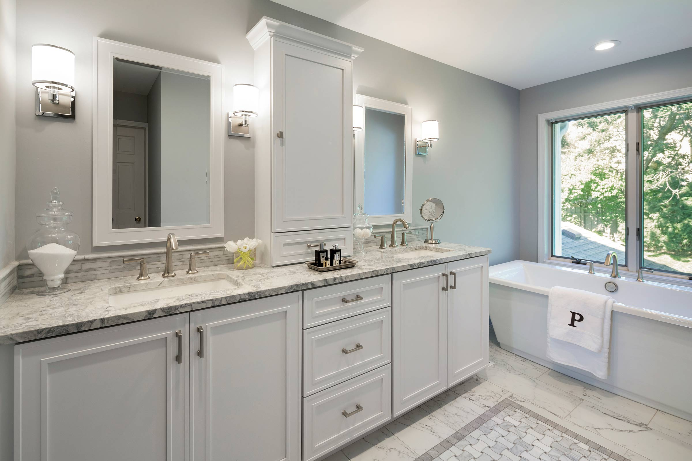 Maven Design Studio Portfolio - Bathroom design with double vanity, marble countertops, white cabinets