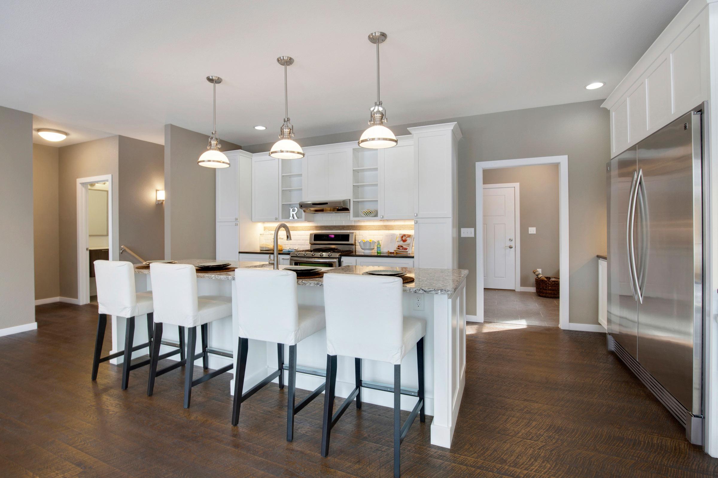 Maven Design Studio Portfolio - Kitchen remodel with dark floors, white cabinets, stainless steel