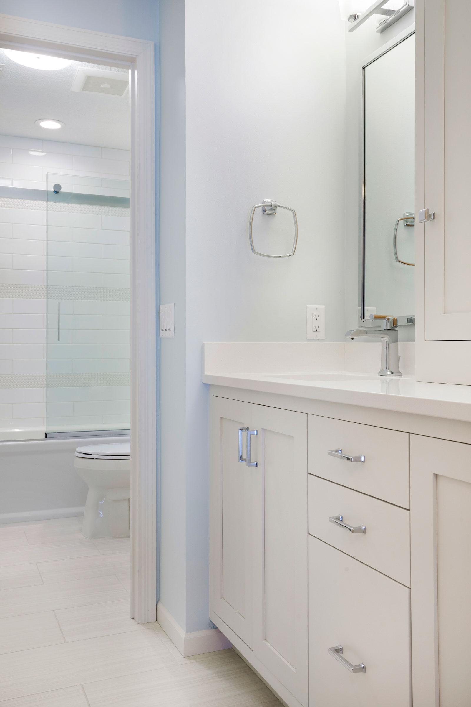 Bath design for teenage girl, light walls and vanity, silver hardware - Maven Design Studio