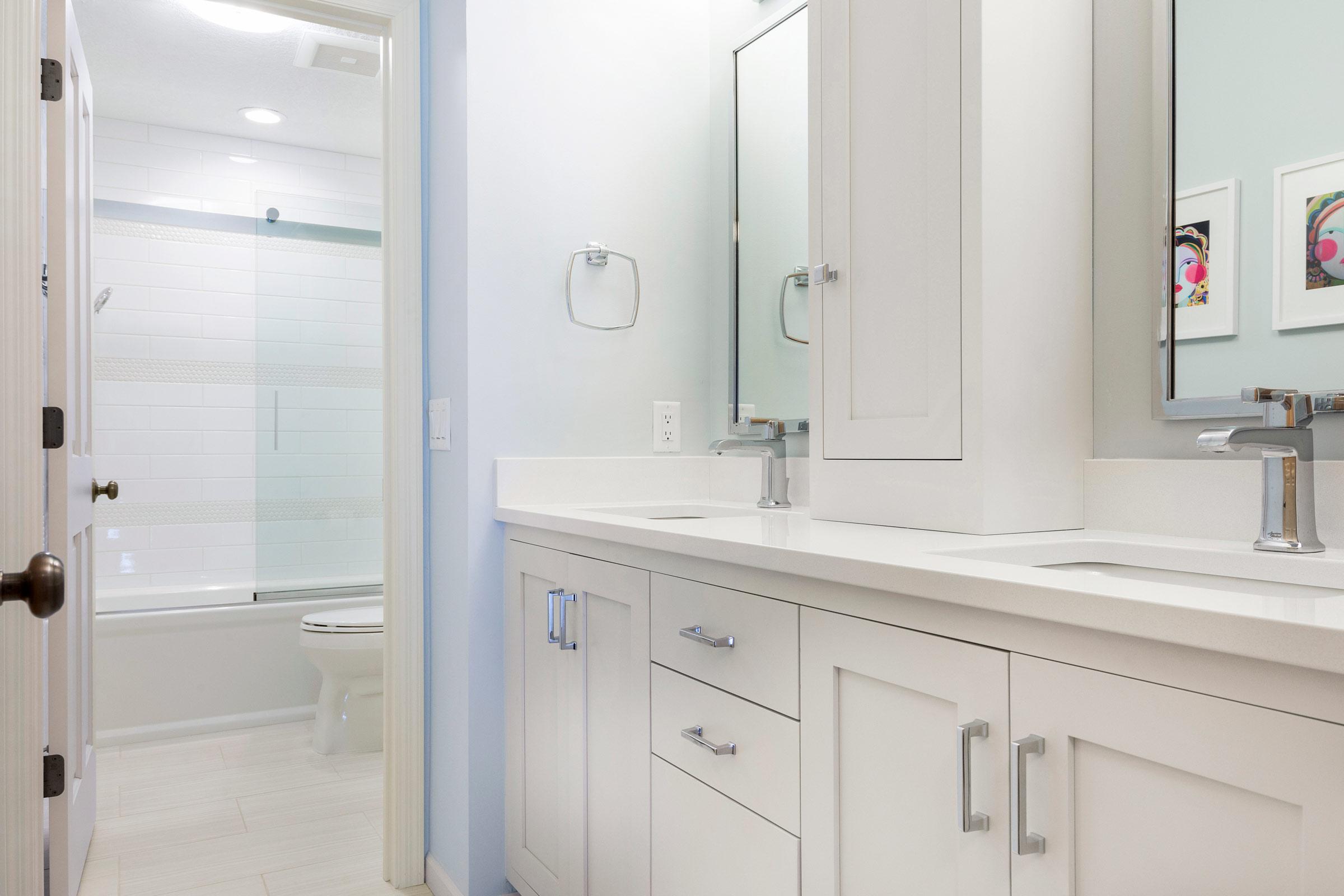Bath and shower design for teenage girl, double vanity, light walls and cabinets, white tile - Maven Design Studio