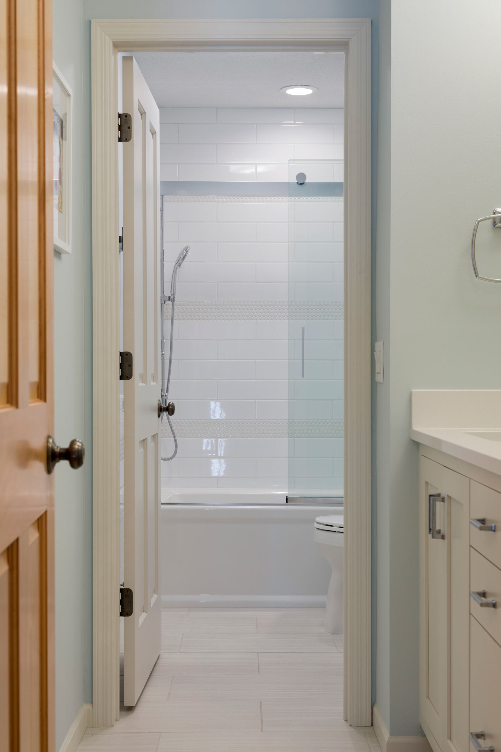 Bath design for teenage girl, walk through view from vanity to shower - Maven Design Studio