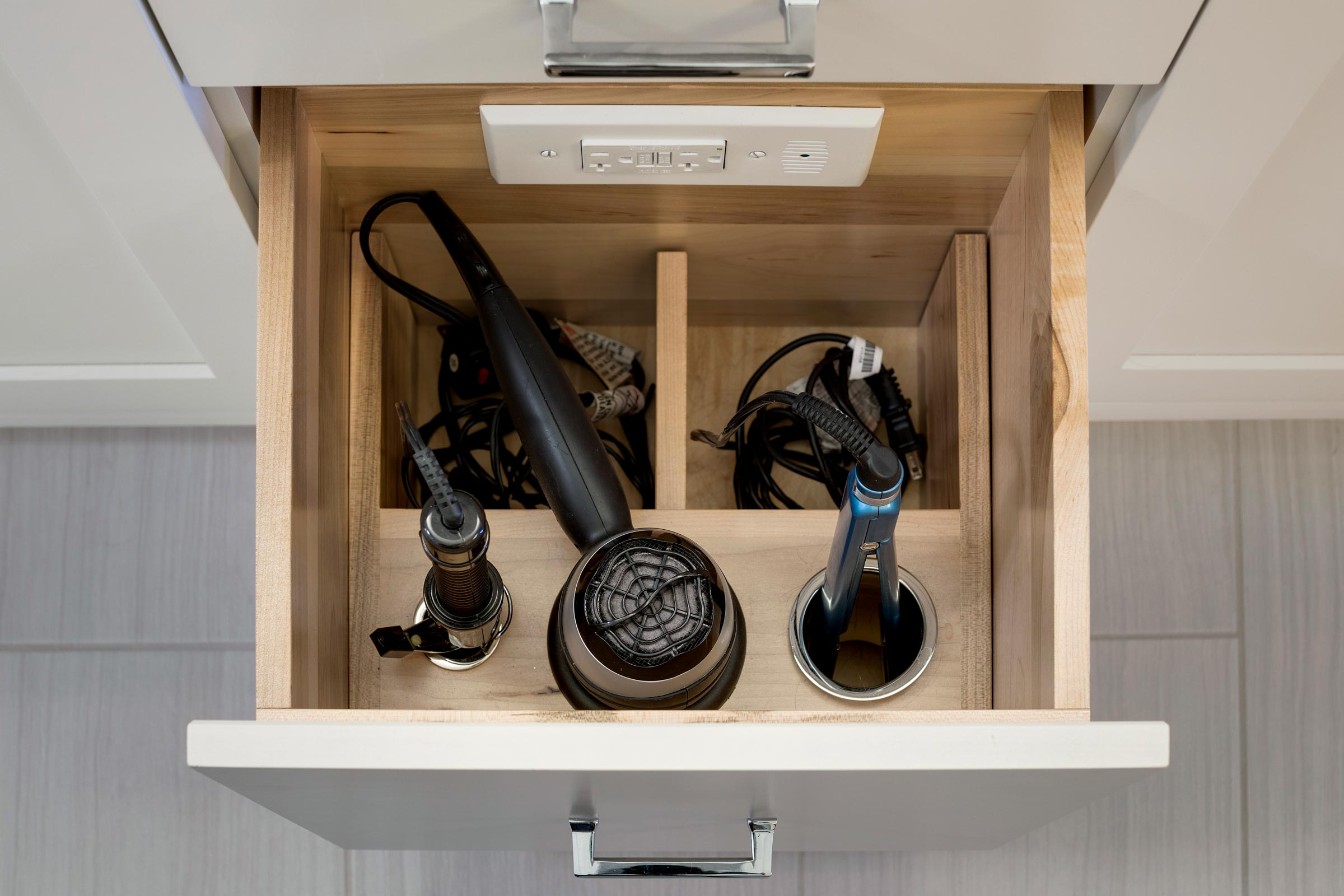 Functional bathroom design for teenage girl, with outlets inside drawers for hair dryers and irons - Maven Design Studio