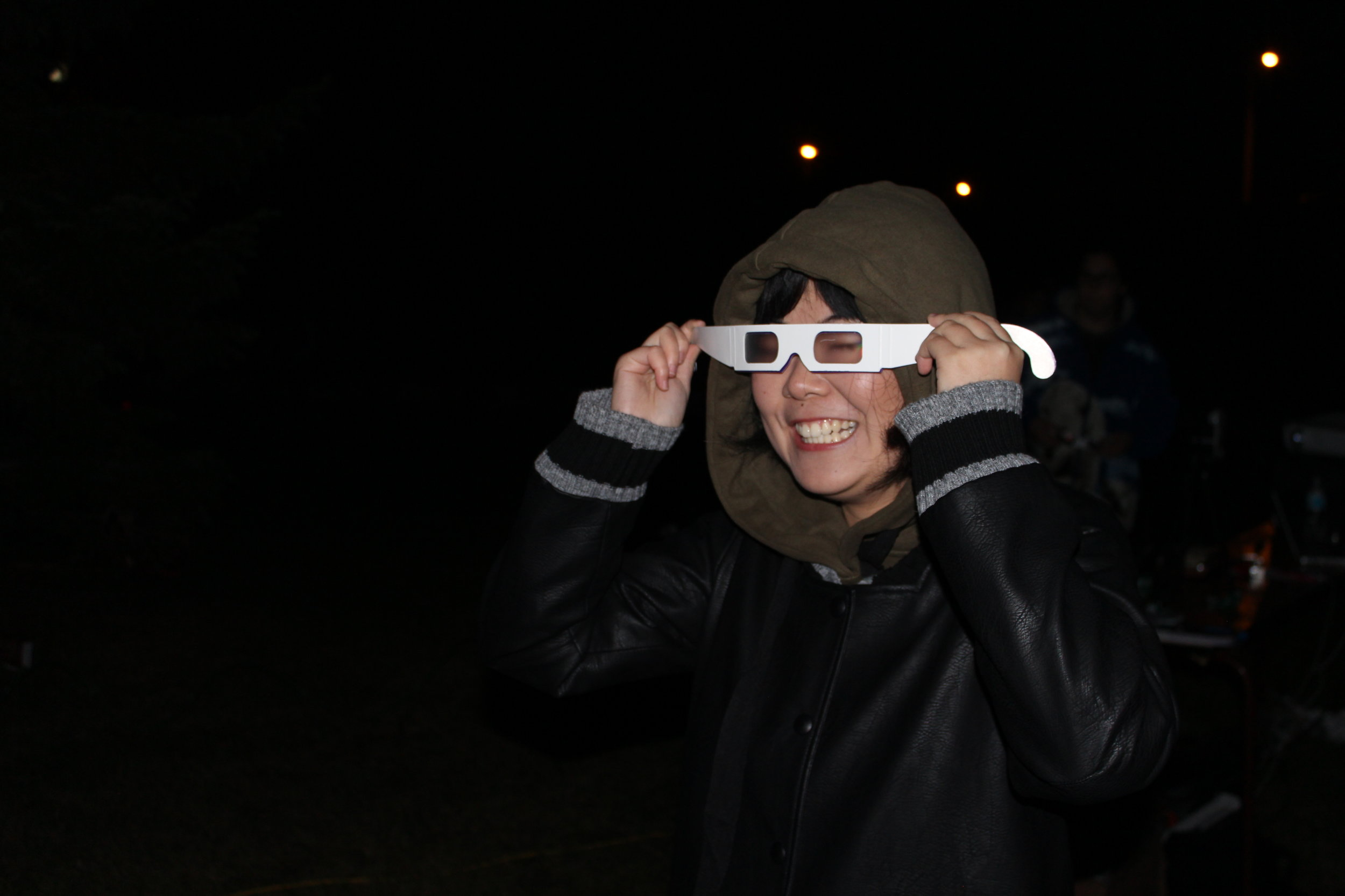 One of our students, Gen, having fun with the diffraction grating glasses.