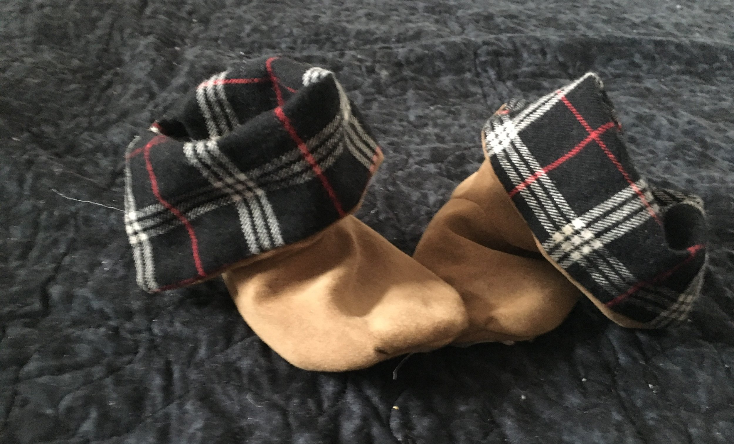 - aaaaand some baby booties! The outside is from an insane men's shirt I found at the thrift shop and used (along with a second hand monkey costume)to make a baby Ewok costume for halloween!
