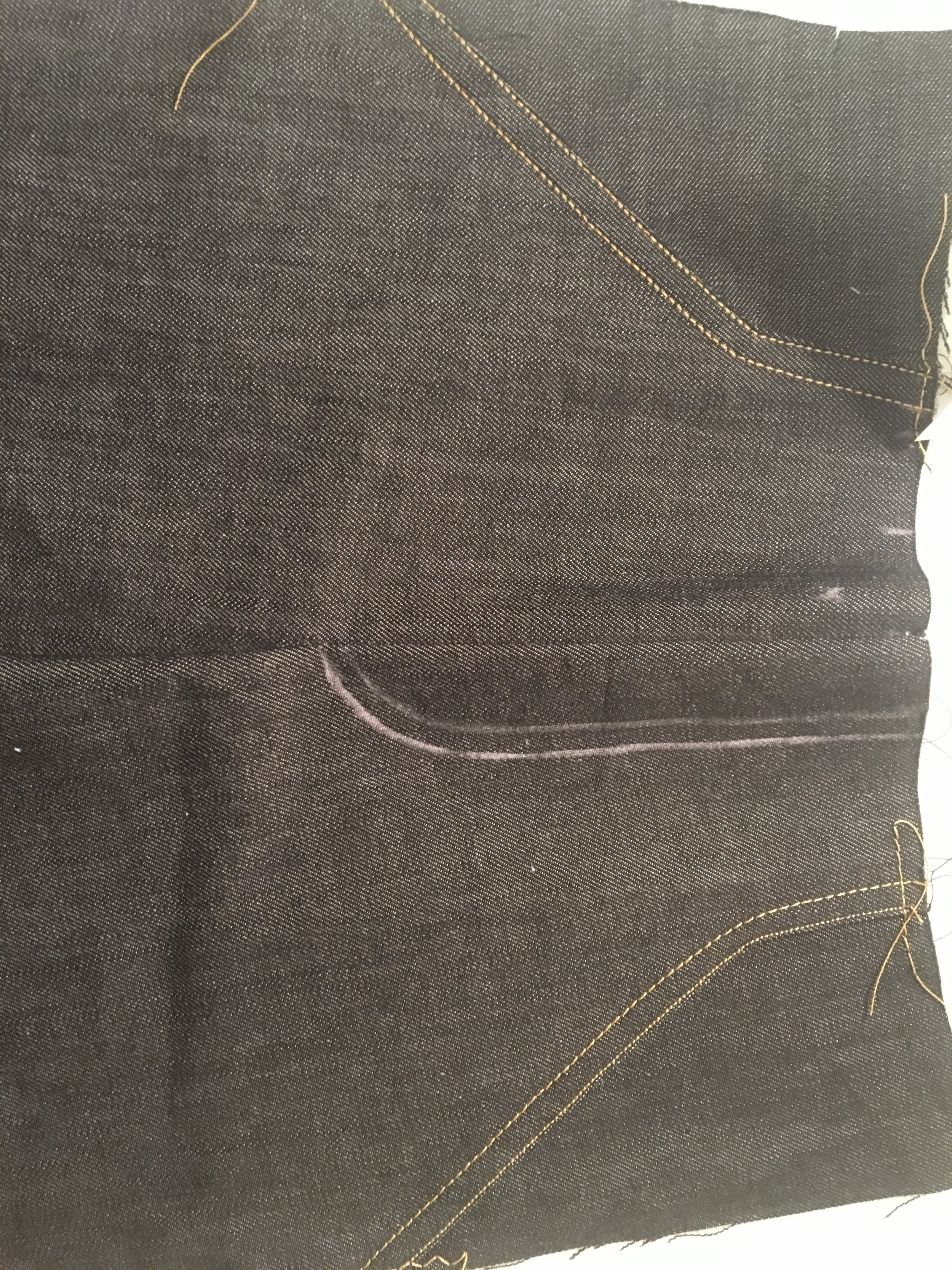 assembled pants front, chalked for fly topstitching guides