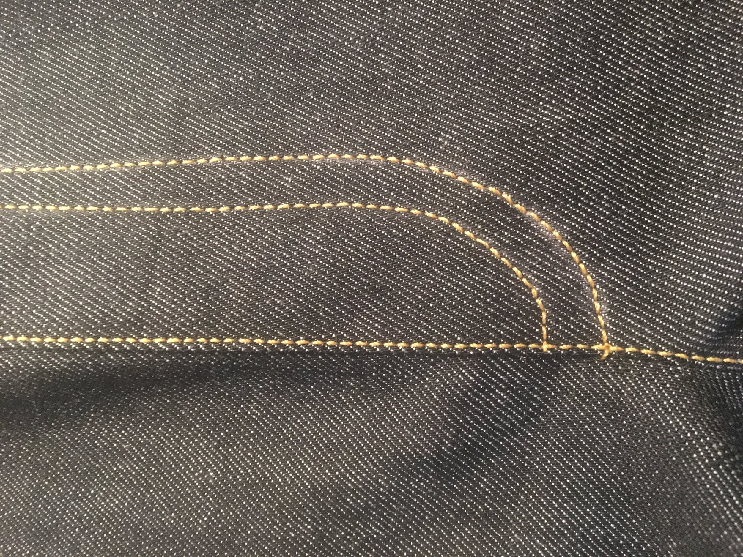 jeans fly topstitching, slightly wobbly