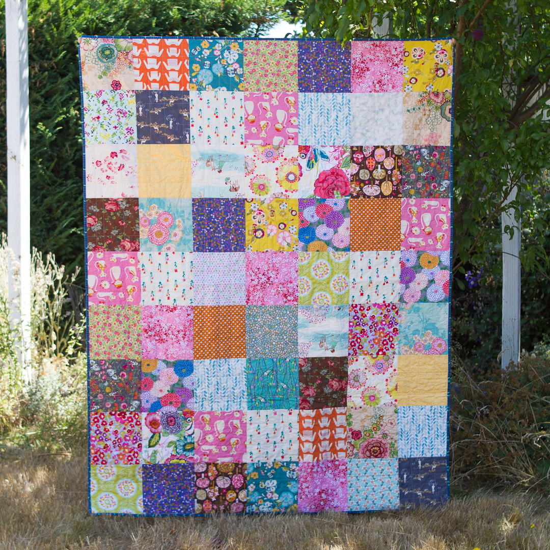 Little Girls's Boho Squares Quilt Finished via www.helloquilting.com