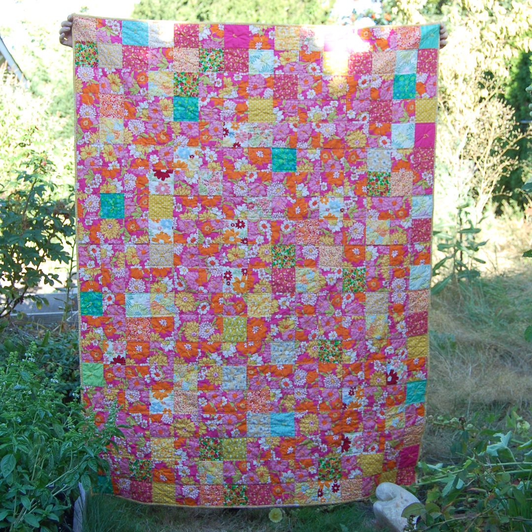 Bright Pink Sunshine Squares Quilt Finished via www.helloquilting.com