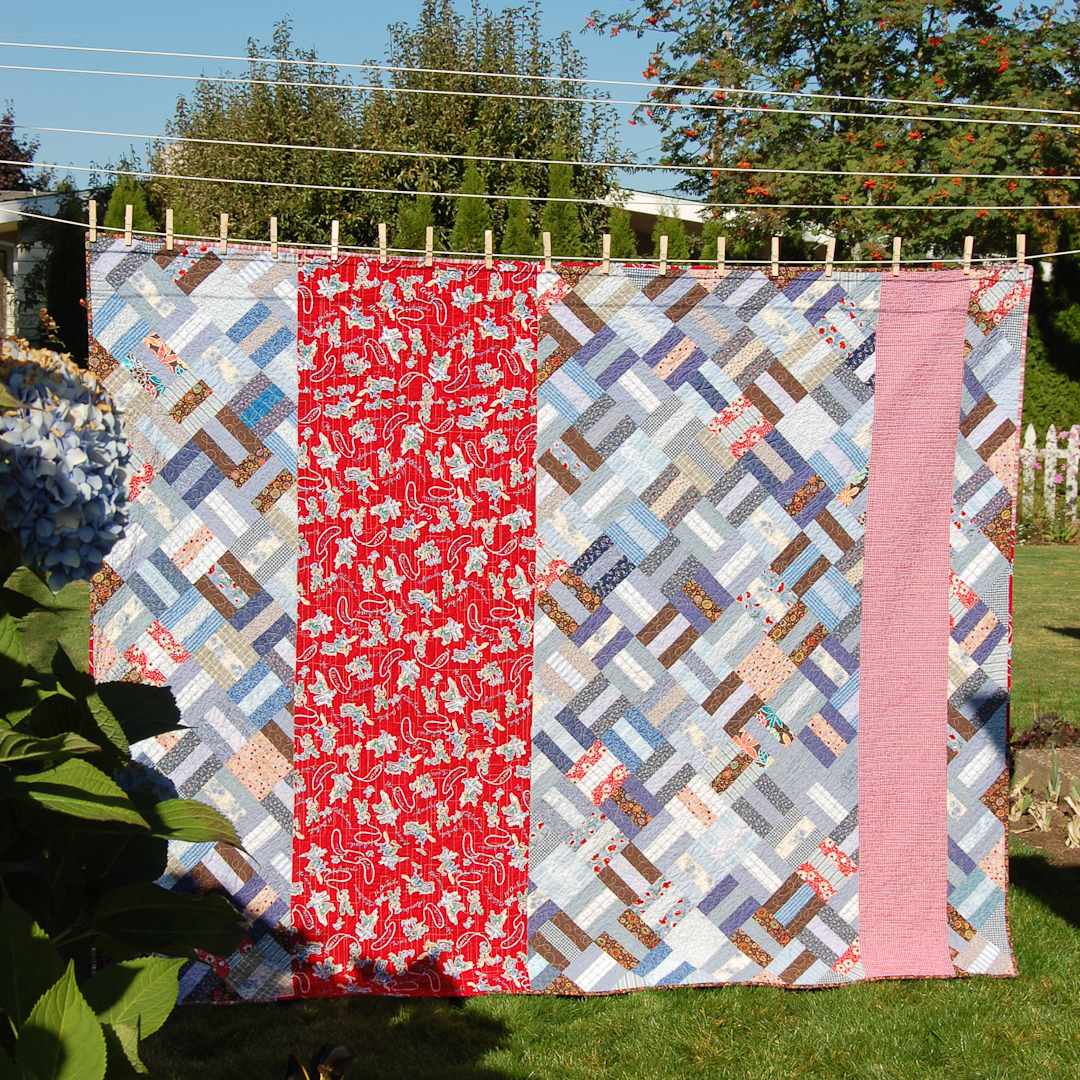 Red & Blue Post-and-Rail Fence Quilt Finished via www.helloquilting.com