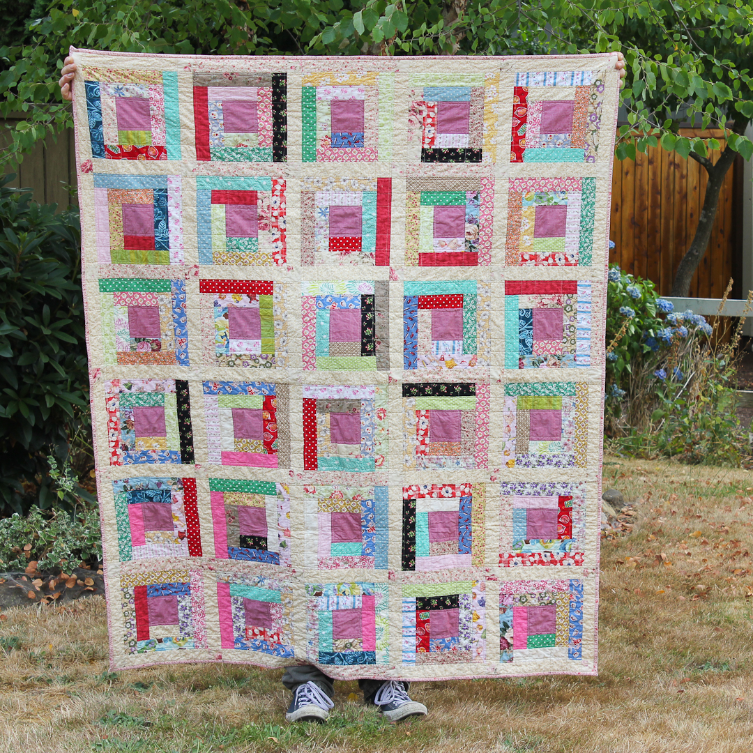 Prairie-Inspired Scrappy Log Cabin Quilt Finished via www.helloquilting.com