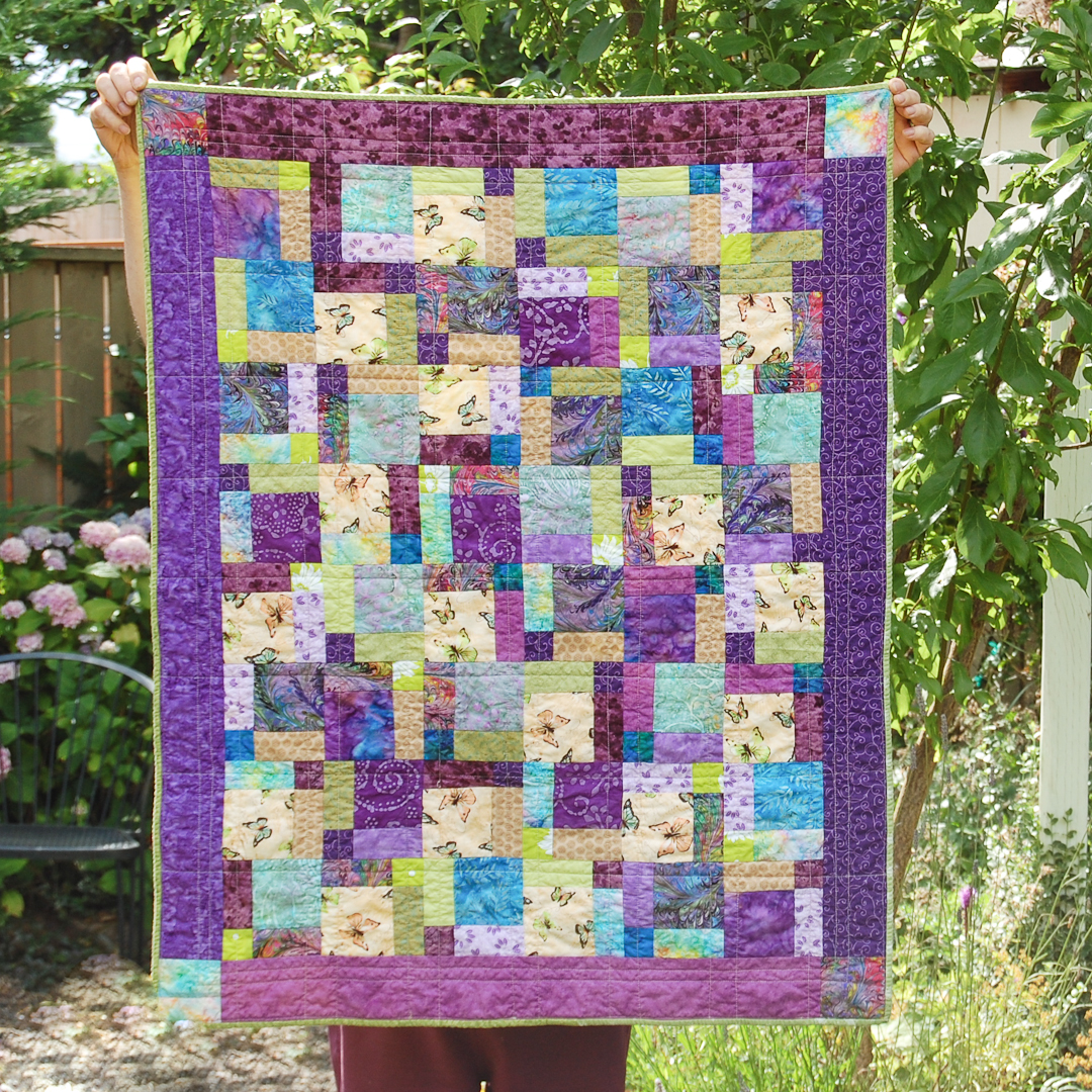 Purple Disappearing Nine-Patch Baby Quilt Finished via www.helloquilting.com