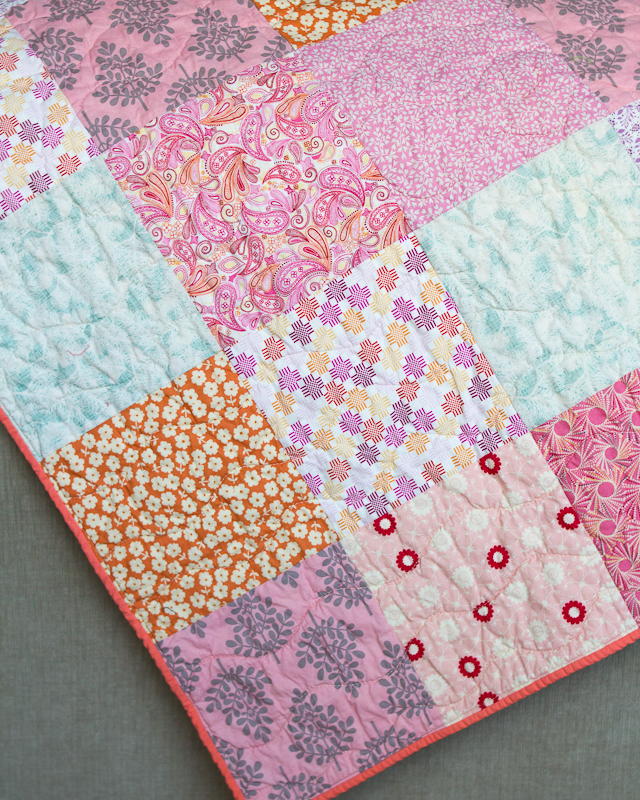 Pink Sister Squares Baby Quilt Corner via www.helloquilting.com
