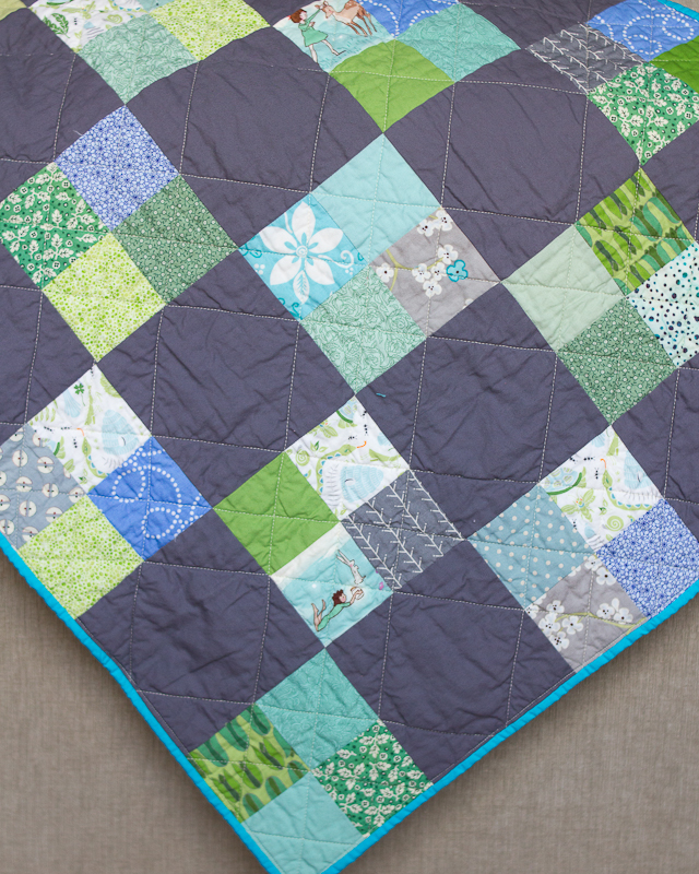 Woodland Four Patch Baby Quilt: Blue, Green and Gray Corner via www.helloquilting.com