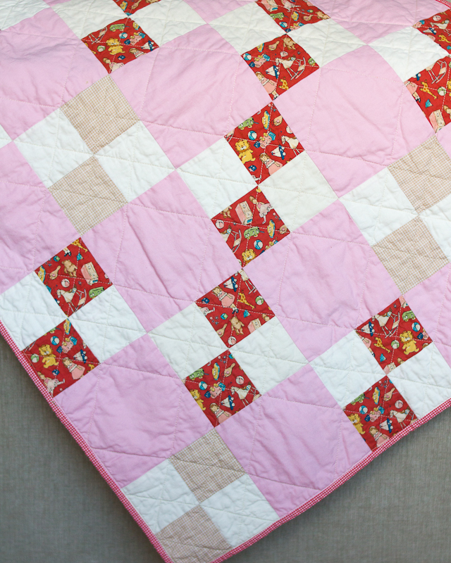 Farmhouse Four-Patch Baby Quilt: Pink & Red Corner via www.helloquilting.com