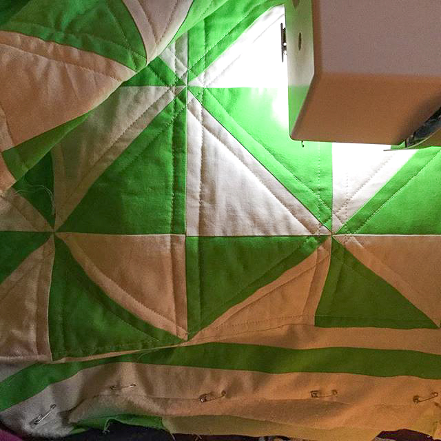 Green & White Pinwheel Quilt Quilted via www.helloquilting.com