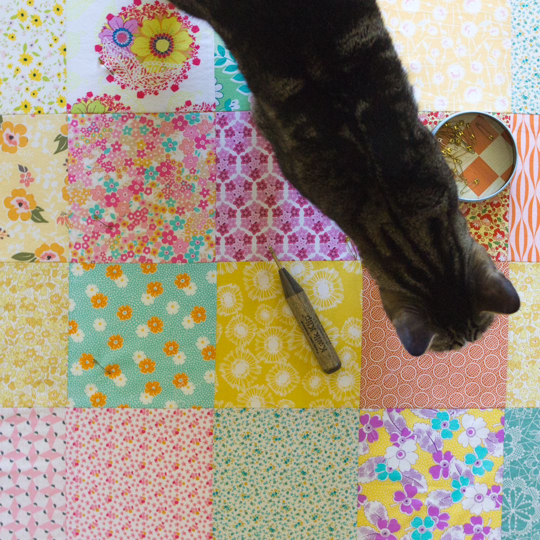Vintage-Sheet-Inspired Scattered Extra-Large Squares Quilt Pinned via www.helloquilting.com