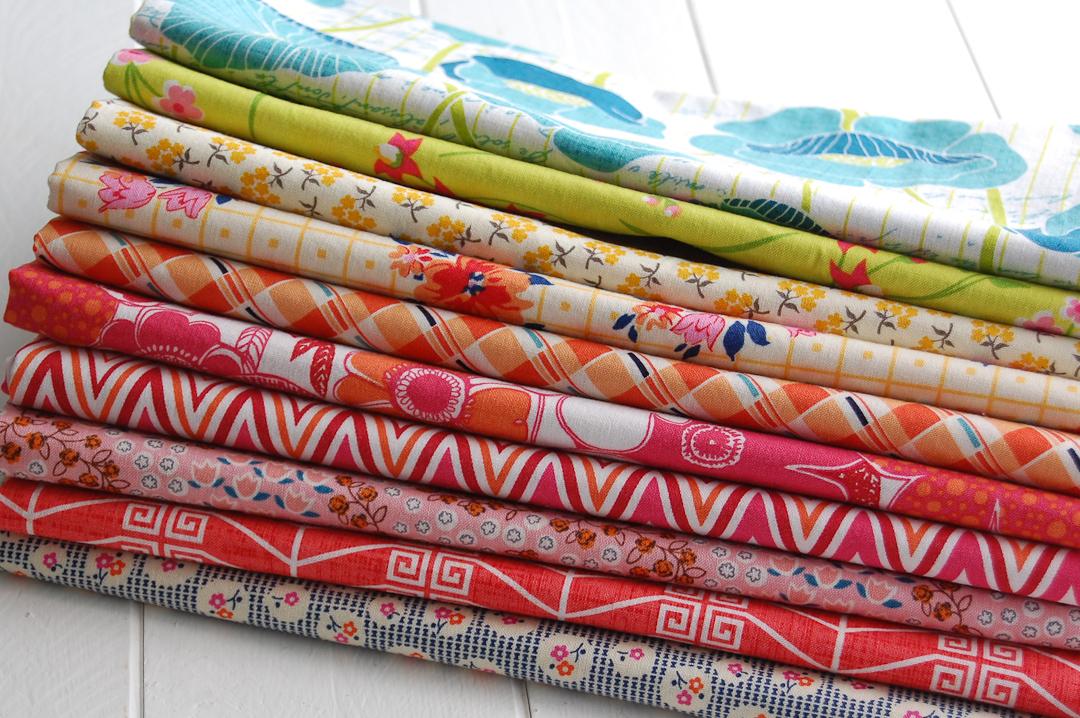 Summer Brights Churn Dash Quilt Fabric Pull via www.helloquilting.com
