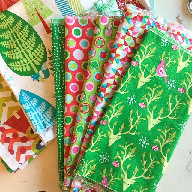 Scrappy Christmas Triangles Quilt Fabric Pull via www.helloquilting.com