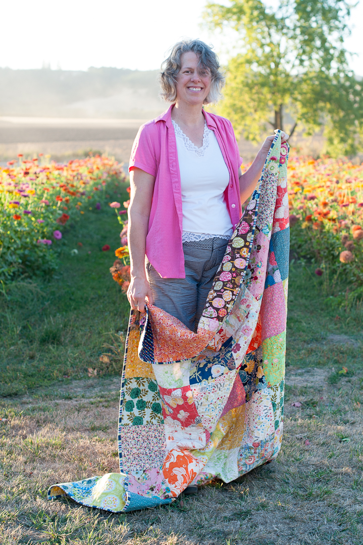 Angela with a Boho Squares Quilt via www.helloquilting.com