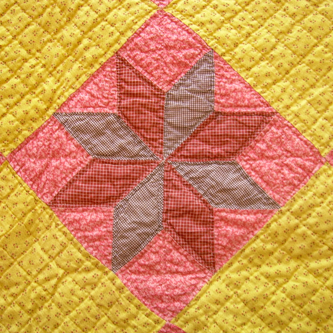 Single LeMoyne Star Block from Antique Chrome Yellow and Double Pink Quilt via www.helloquilting.com