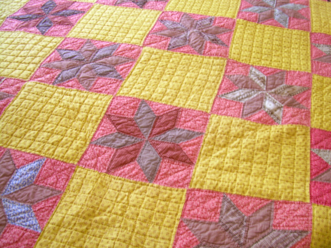 Antique Chrome Yellow and Double Pink LeMoyne Star Quilt via www.helloquilting.com