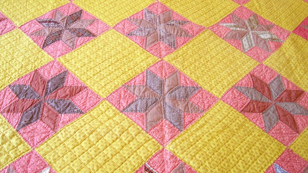 Antique LeMoyne Star Reproduction Quilt via www.helloquilting.com