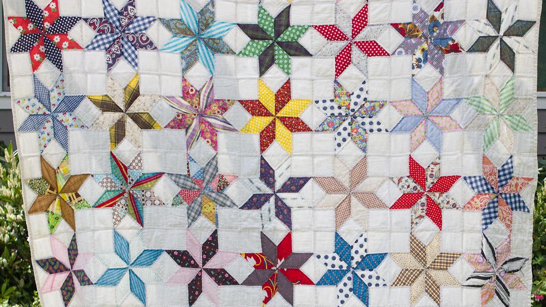 Vintage LeMoyne Star Reproduction Quilt via www.helloquilting.com