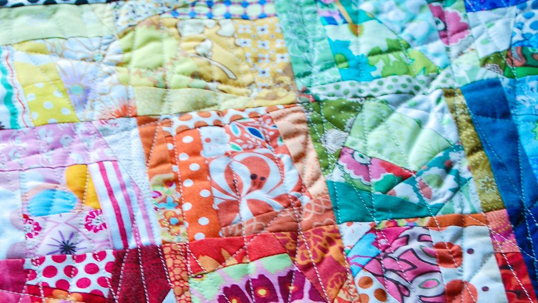 Crazy Squares Doll Quilt via www.helloquilting.com