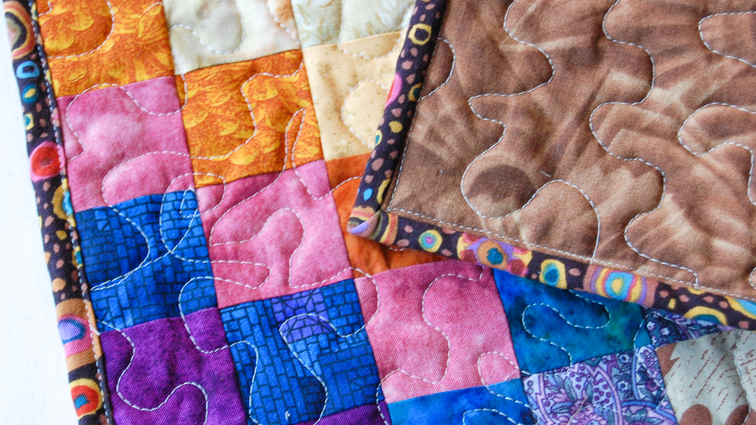 Scrappy Bargello Quilted Placemat via www.helloquilting.com