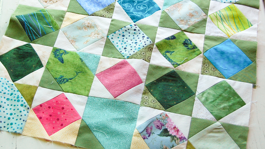 Checkered Square-in-a-Square Quilt via www.helloquilting.com