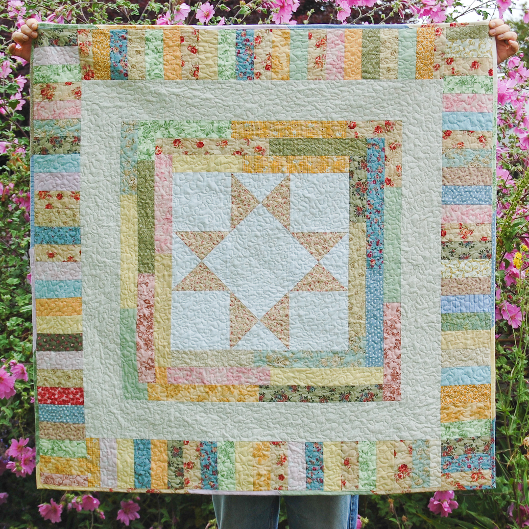 Ohio Star used in Star Medallion Baby Quilt via www.helloquilting.com