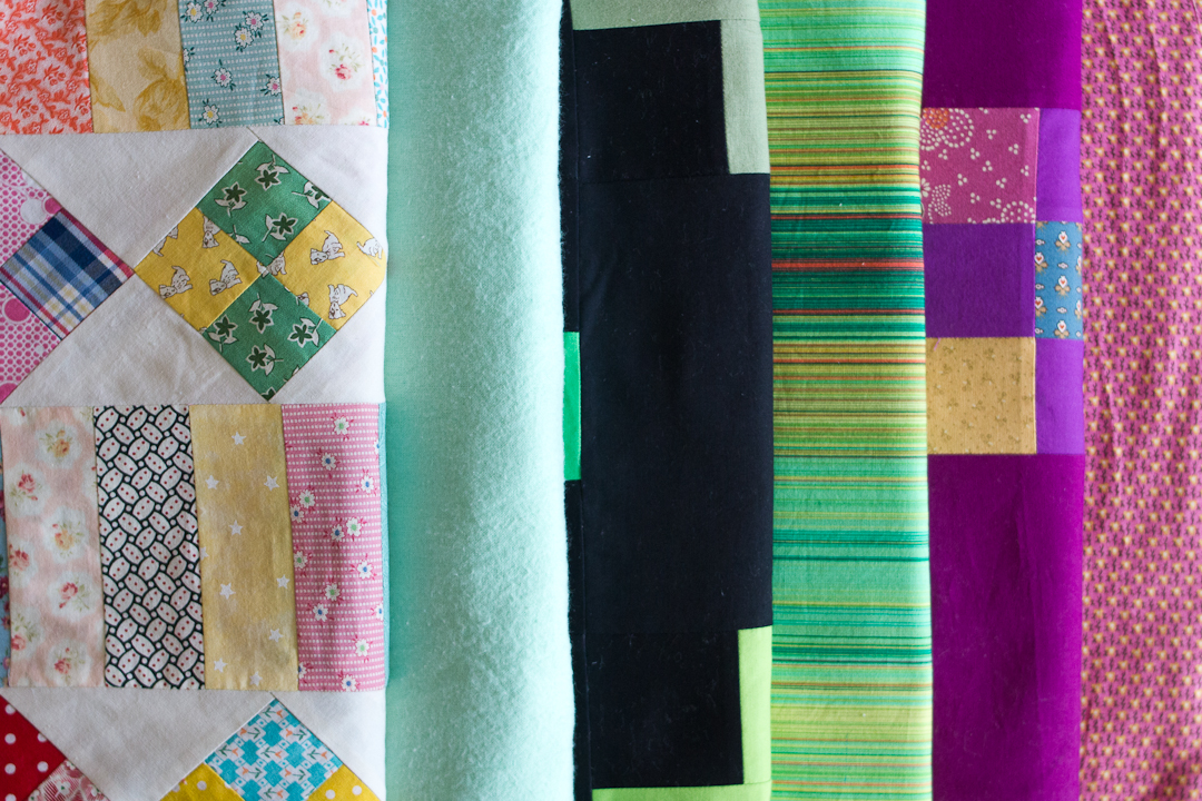 Stack of WIP Quilts via www.helloquilting.com