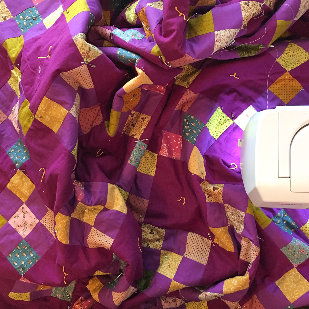 Quilting the Purple Irish Chain Quilt via www.helloquilting.com