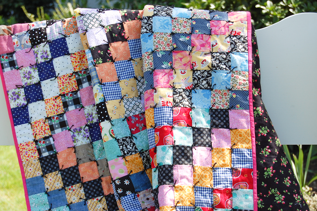Antique-Inspired Scrappy Trip-Around-the-World Quilt Finished via www.helloquilting.com