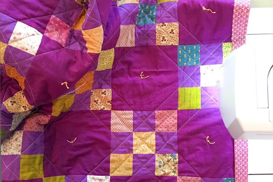 Binding the Purple Irish Chain Quilt via www.helloquilting.com