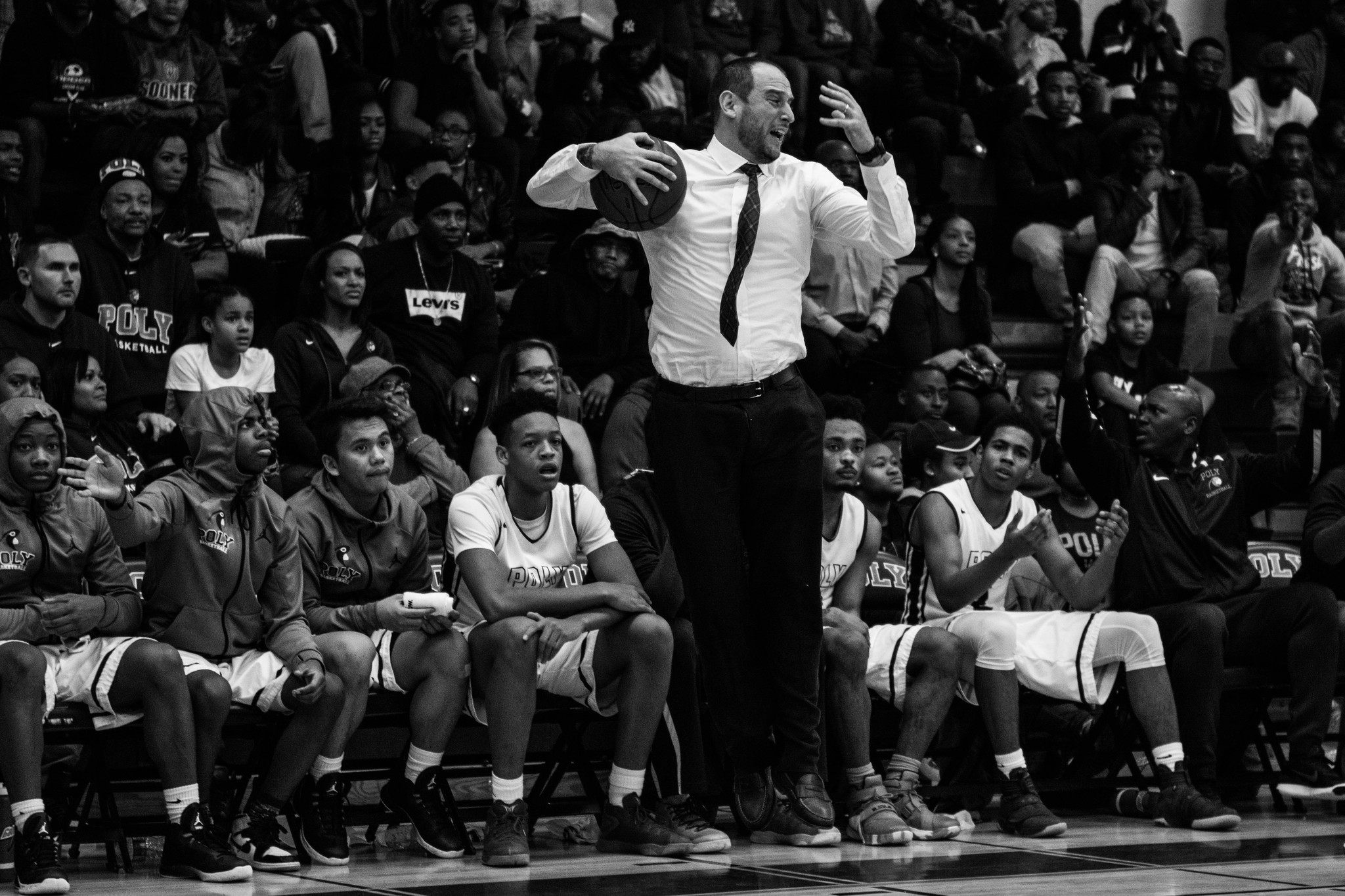 Coach Sam angrily jumps after a questionable call during a game against Chicago's Simeon Academy.  Photo Credit: City Paper, Reginald Thomas II