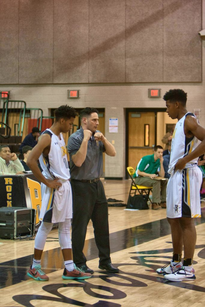 Coach Breslaw providing on-the-court instruction to his players. | Photo Credit: prephoops.com