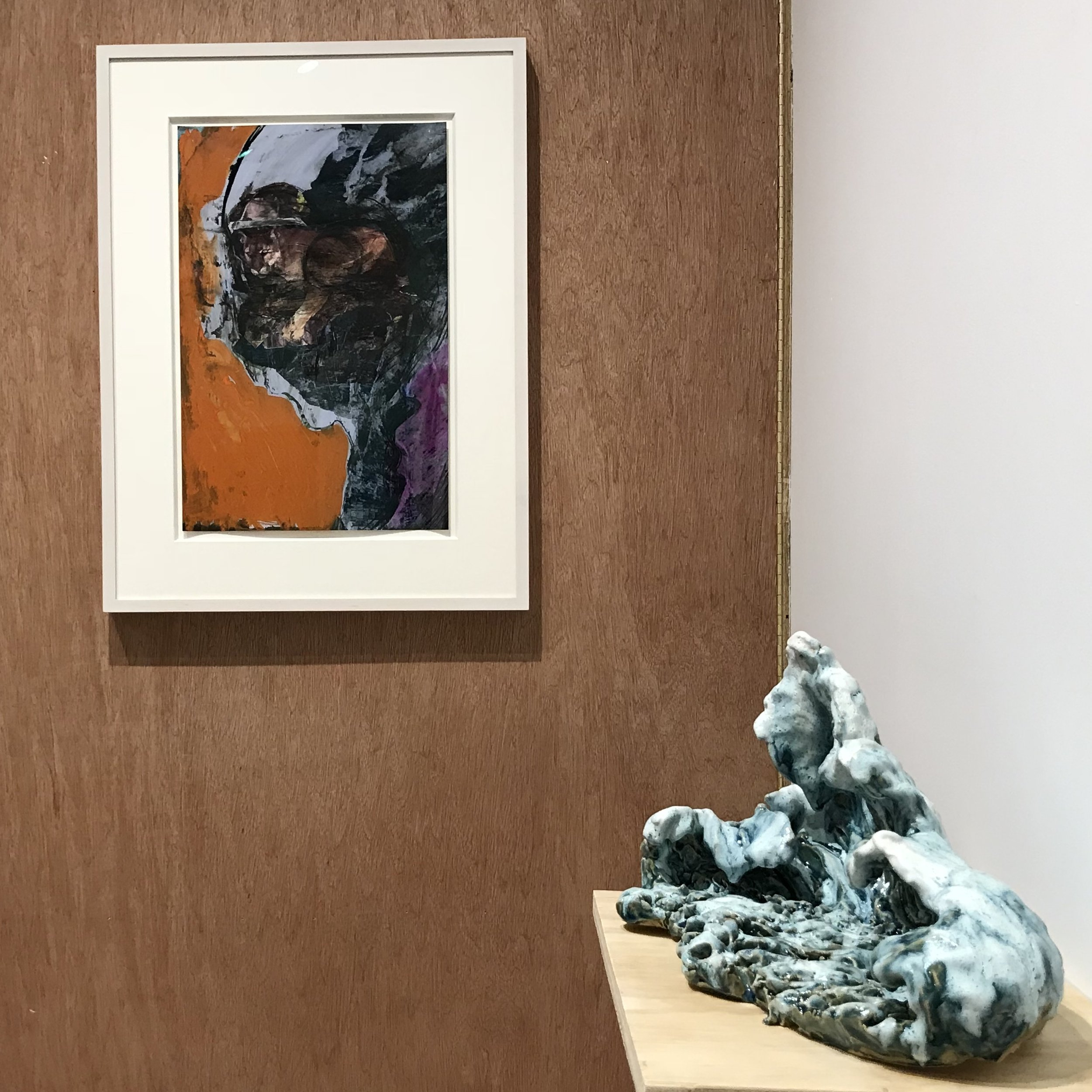 Huma Bhabha ,  Untitled , 2013, Ink and collage on color photo, 20 7/8 x 14 inches.   Chris Hammerlein ,  Untitled , 2018, Glazed ceramic, 8 3/4 x 16 x 8 inches.