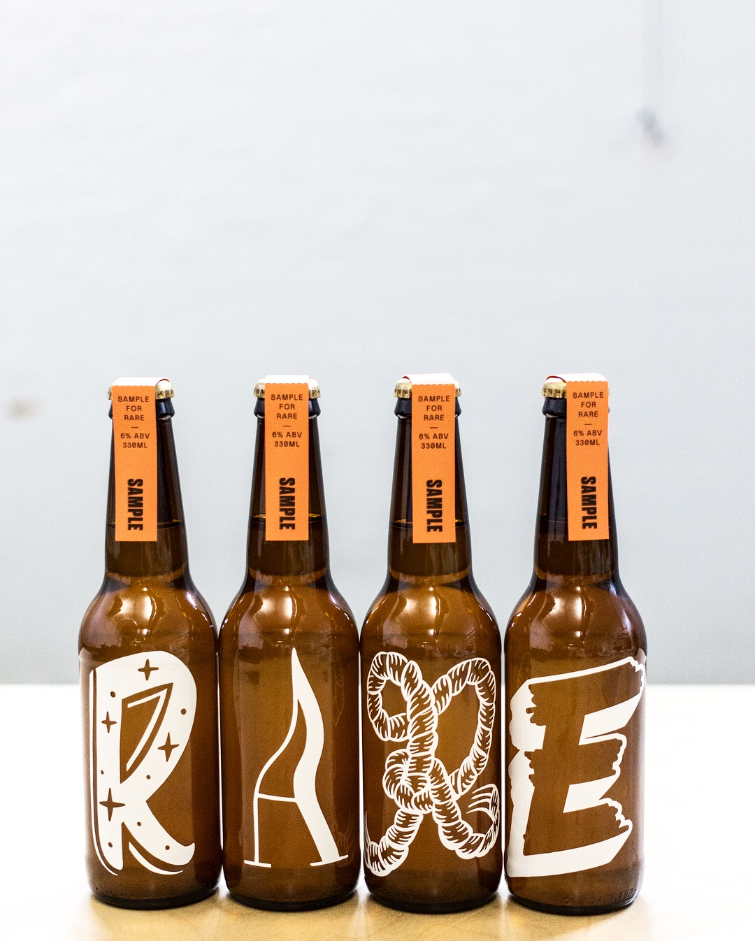 GEMMA O'BRIEN xMADDY RITCHIE - Lettering designs for RARE festival. Vinyl stickers on beer bottles; assisted in the design, application of stickers + photography.Sydney, Australia