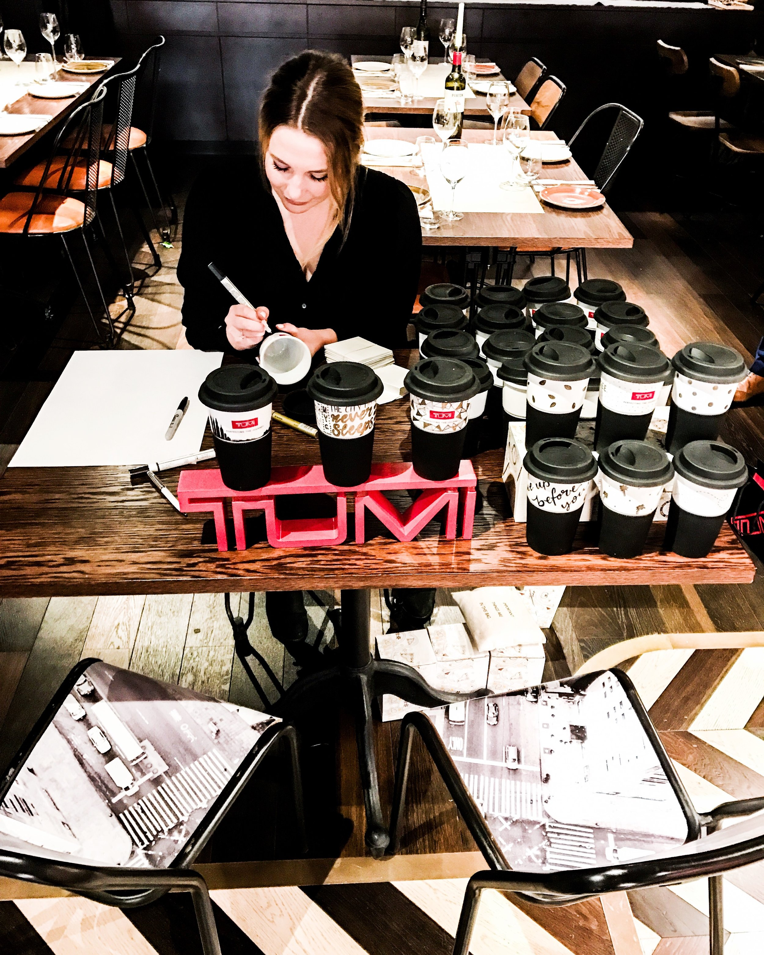 TUMI xMADDY RITCHIE - Customising keep cups at launch eventSydney, Australia