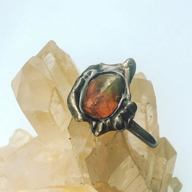 An extra special opal ring for a most patient, persistent, and gentle soul. Her opal was rough but delicate, so we opted to encase her halfway in resin for durability and safety. Not all gems are willing to take the pressure of cutting, polishing, setting, and wearing. I am very pleased with this compromise and wish them many many years of great adventures!!! 🌈🤸♀️🔥❤️🌝 #roughopal #fireopal #ethicalfinejewelry #bespokejewelry #fairyjewelry #magicaljewelry #handcraftedjewelry #craftswoman #rawjewelry #jewelryforthesoul #contemporaryartjewelry #alternativejewelry #otherworldly #mysticaljewels #madeiniowa #byhandwithlove