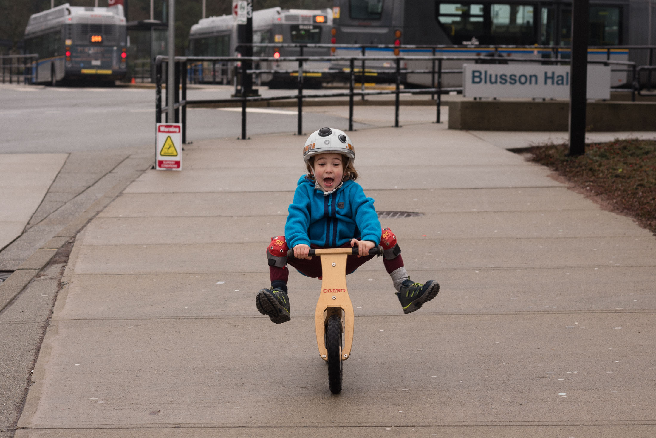 A boy lifts his feet while riding his bike in Burnaby, BC.