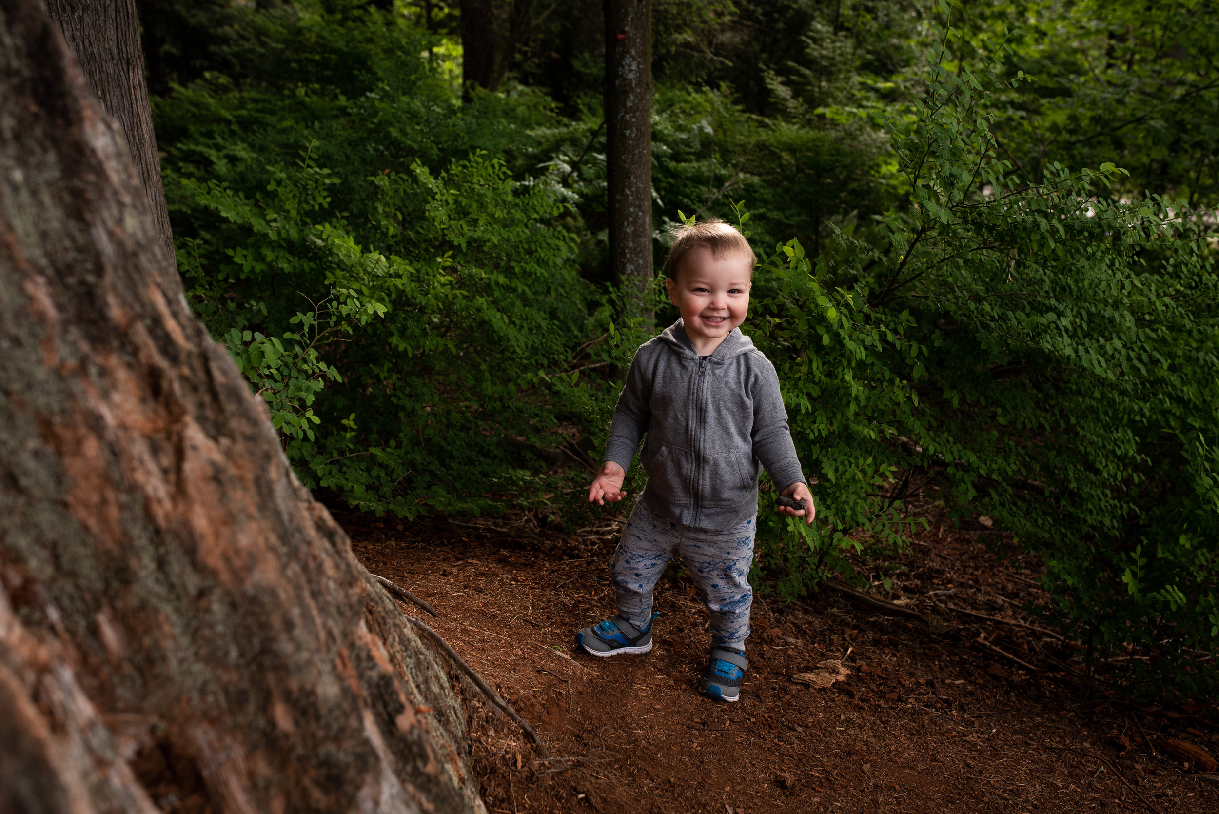Kid running away from the photographer in Burnaby, British Columbia.